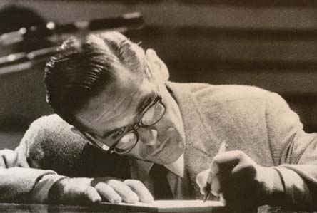 Bill Evans writing at the piano.
